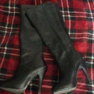 Knee high black high heeled boots